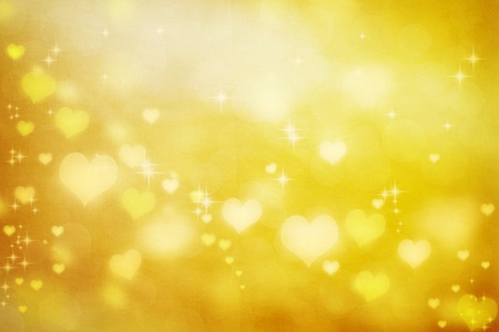 Golden shiny hearts on fabric texture background  Stock Photo