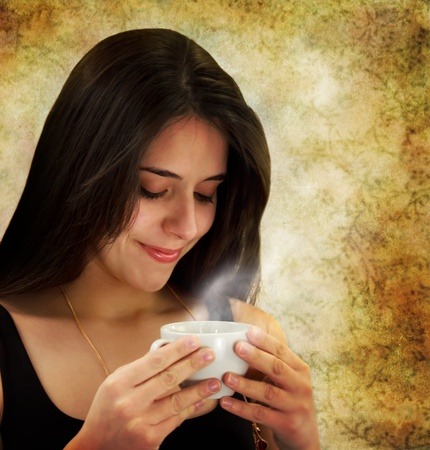 Beautiful young woman holding a coffee cup  Imagens