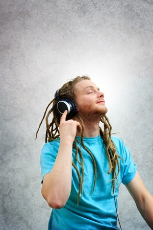 Young Man Listening to Music on Headphones photo