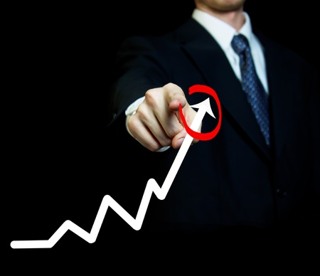 achievment: Businessman highlighting business growth on a graph Stock Photo