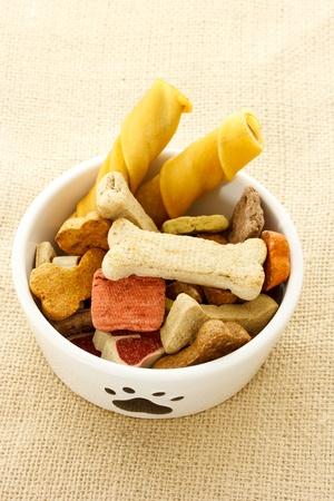 Dog food in dog bowl on burlap cloth Reklamní fotografie