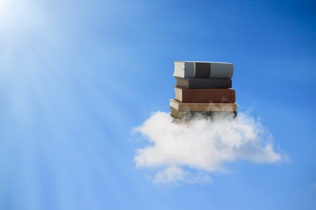 Beautiful books floating on a cloud (concepts of reading, education, knowledge enlightenment) Stock Photo - 12674766