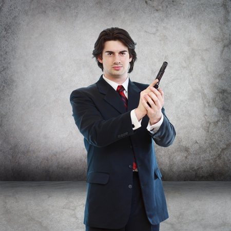 Handsome Man with a Hand Gun (agent, assassin, etc) Stock Photo