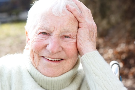 Happy Elderly Woman in Wheelchair Smiling Stock Photo - 12674770