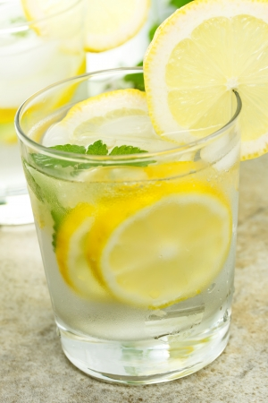 Fresh Lemonade in a Glass with Lemon Slices  photo