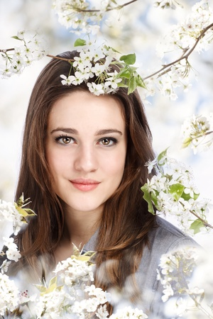 Portrait of a Beautiful Girl with a Blooming Tree Stock Photo - 13123837