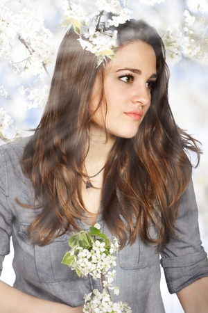 Portrait of a Beautiful Girl with Flowers from a Blooming Tree Stock Photo - 13123868