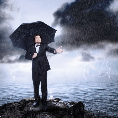 storm coming: Stylish Man with Umbrella Checking for Rain (storm clearing or coming)
