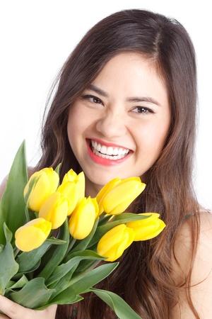 Beautiful Young Women Holding Yellow Tulips photo
