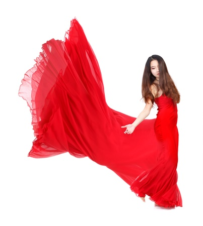 flowing hair: Beautiful Young Woman in Flowing Red Dress on White Background