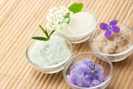Bath salt with flowers on bamboo matt photo