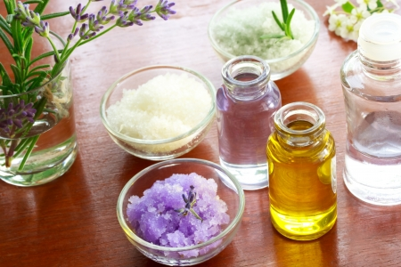 Bath salt with aromatherapy oil on wooden board photo