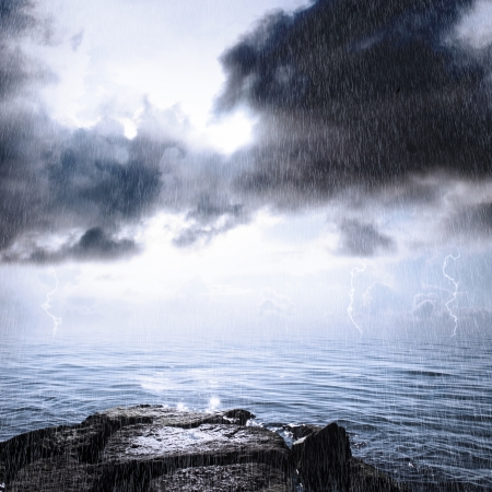 Rain and thonderstorm in the ocean with sunlight photo