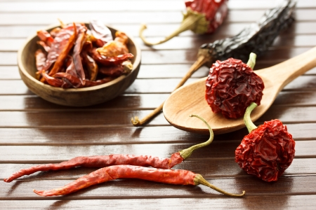 manifold: Assortment of dried chili peppers  on wooden matt