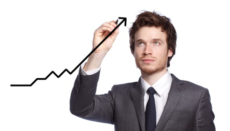 Businessman drawing a graph with black marker photo