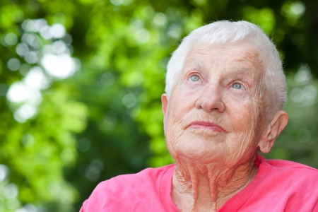 Senior Woman in a Wheelchair Looking up Stock Photo