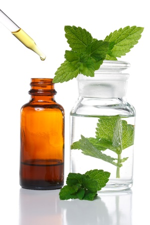 Herbal medicine dropper bottle with mint leaves