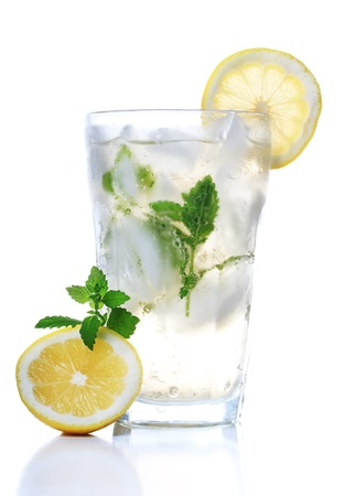 Cold soft drink with lemon and mint photo