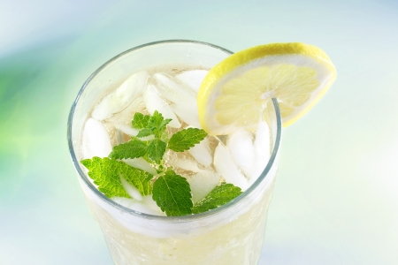 balm: Ice-cold Lemonade with fresh slice of lemon and lemon balm (mint) Stock Photo
