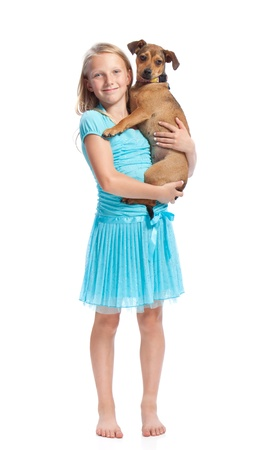 blond brown: Young Girl in Light Blue Dress Holding her Dog