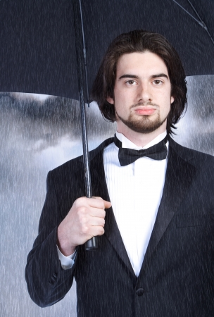 Portrait of a Young Stylish Man with Umbrella photo