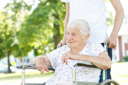 caretaker: Senior Women in a Wheelchair with her Caretaker Stock Photo