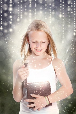 mystical woman: Happy Young Blonde Girl Opening a Gift Box Stock Photo