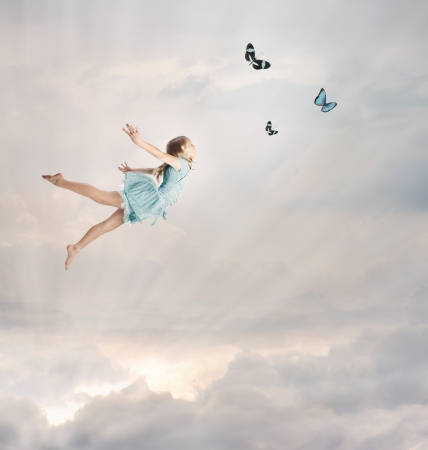 woman flying: Little Blonde Girl Flying with Butterflies at Twilight