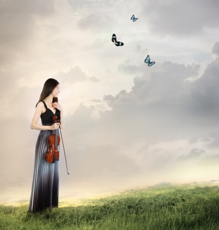 woman violin: Violin Player on a Mountain Top  with butterflies