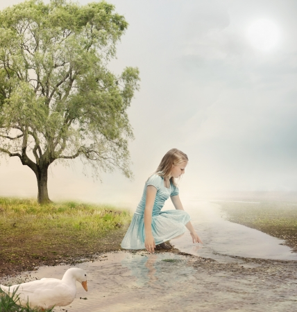 little girl dress: Young Blonde Girl at the Brook  Stock Photo