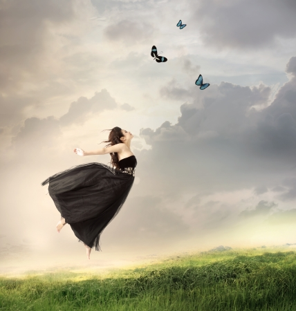 fantasy landscape: Beautiful Girl Jumping in the Air on a Mountain