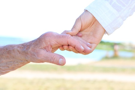Senior women holding hands with caretaker Stock Photo - 14841843