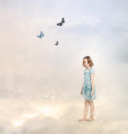 Girl in the Clouds with Butterflies photo