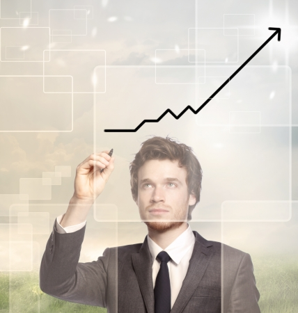 Businessman drawing a graph with black marker (growth) photo