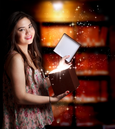 Happy Young Woman Opening a Gift Box Stock Photo - 15190452