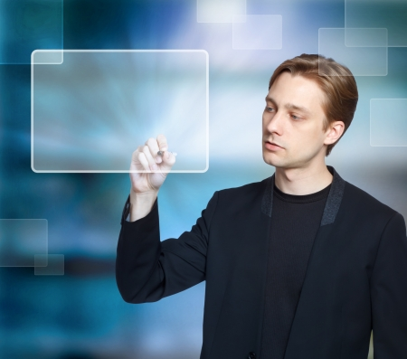 new media: Man pressing modern virtual touch screen buttons with a blue background
