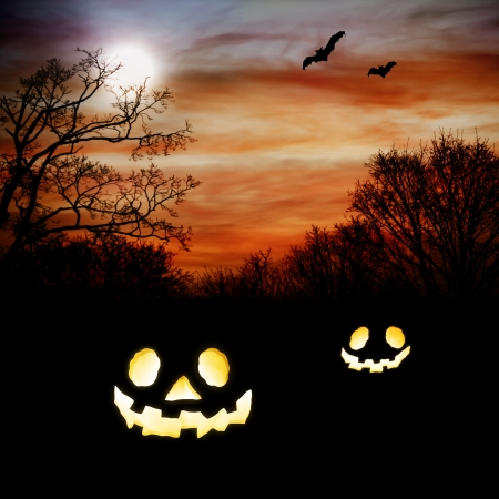 Jack O Lanterns with Autumn Scenery with bats photo