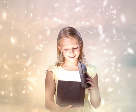 mystical woman: Happy Blond Girl Opening a Gift Box Stock Photo