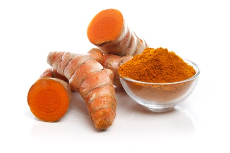 Turmeric roots and powder on white background Stock Photo