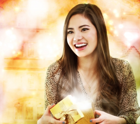 opening gift: Happy Girl Opening a Gift Box