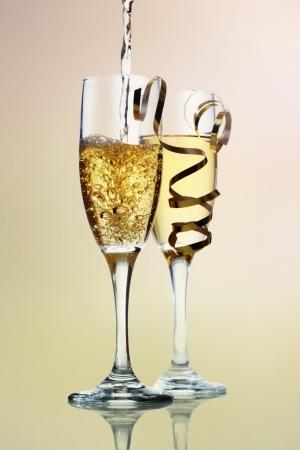 Champange being poured into champange glasses Stock Photo