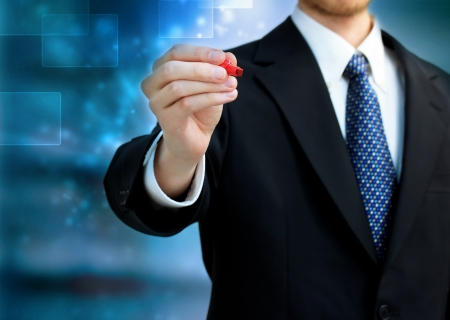 shiny suit: Young business man holding a red pen Stock Photo