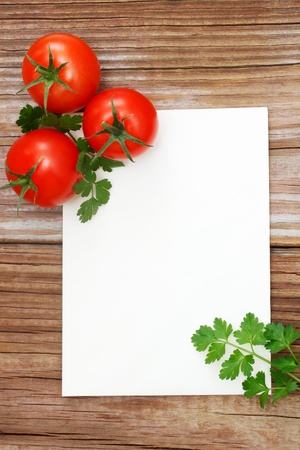 Tomatoes on Wood with white notepad photo