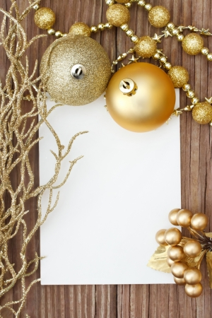 silver frame: Gold Christmas ornaments on wood  Stock Photo
