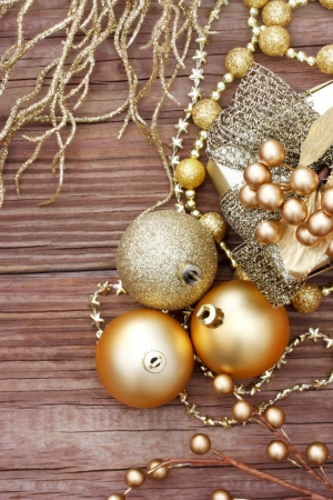 Gold Christmas ornaments on wood  photo
