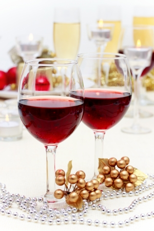 Glasses of champagne and candles: Red wine at Christmas dinner