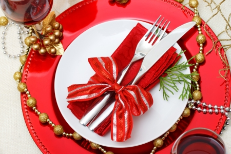 Christmas plate and silverware with red wine photo