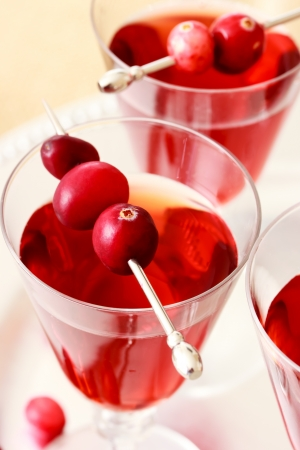 garnish: Berry juice with cranberry garnish  Stock Photo
