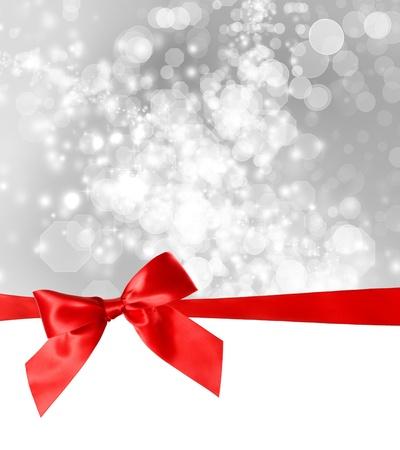 happy holidays: Red Bow en Ribbon met Bokeh Lichten Achtergrond Stockfoto