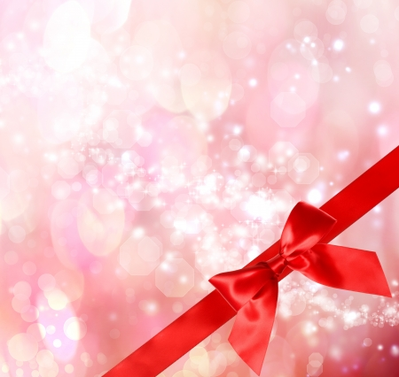 Red Bow and Ribbon with  Pink Bokeh Lights Background  Stock Photo